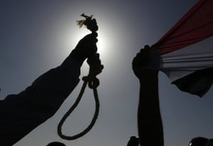 Mubarak in court: An anti-Mubarak protester holds a noose