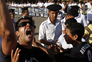 Mubarak in court: A protester shouts slogans against Mubarak  in Cairo