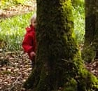Child hiding in a wood