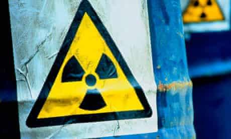 Blue drums displaying radioactive sign
