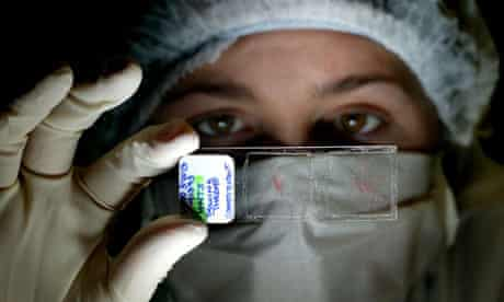 A forensic scientist examines fibres