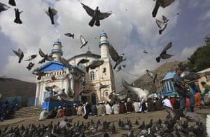 Eid al-Fitr: Kabul, Afghanistan: A policeman patrols as Muslims pray