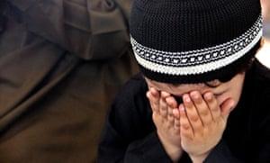 Eid al-Fitr: Peshawar, Pakistan: A child offers Eid al-Fitr congregational prayers