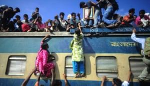 Eid al-Fitr: Dhaka, Bangladesh: People climb onto trains at the airport railway terminal