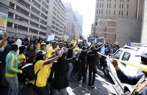 Malema demonstrations: Hundreds of Malema supporters threw stones and bottles at police