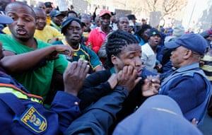 Malema demonstrations: Police restrain a supporter of ANC Youth League leader Julius Malema
