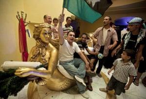 Sean Smith in Libya: 26 August: Rebel fighters sit on the gilded sofa in Aisha Gaddafi's villa