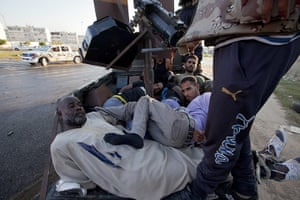 Sean Smith in Libya: 25 August: Rebel fighters take prisoners away from fighting in Abu Salim