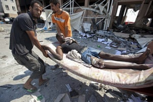 Sean Smith in Libya: 26 August: Rebels bring prisoners out of a building damaged in fighting