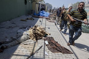 Sean Smith in Libya: 24 August: Rebel reinforcement forces pass bodies as they continue to fight