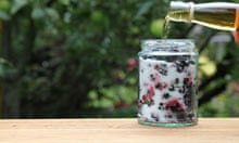 Pouring whisky over the blackberries and sugar