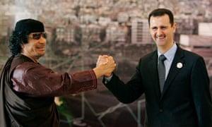 Bashar Assad Muammar Gadhafi