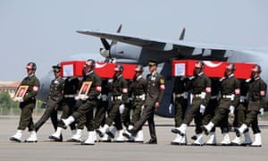 Turkish soldiers carry the coffins of soldiers who were killed in an attack by members of the PKK