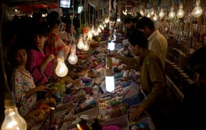 Eid Festival: Women buy traditional bangles at a shop for Eid in Islamabad, Pakistan