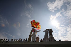 Eid al-Fitr: Kathmandu, Nepal: Revellers release balloons that read 'Happy Eid'