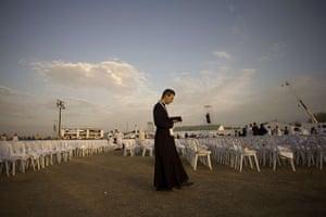FTA: Jorge Guerrero: A priest prays before a mass at the Cuatro Vientos air base