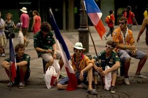 FTA: Jorge Guerrero: Pilgrims sit as they wait for Pope Benedict XVI's visit in Madrid