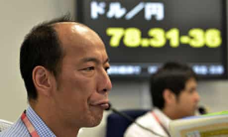 A currency trader during morning trading at a Tokyo foreign exchange market