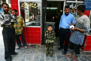 Sean Smith Frontlines: A child dressed in an Iraqi army uniform