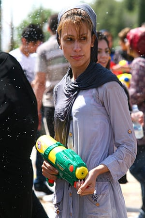 Water gun festival: A woman holds a toy gun