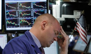 Dow Jones trader watches stocks fall