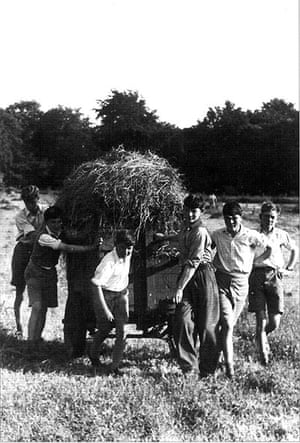 You can help your country: Lord Wandsworth College boys pulling a haywagon