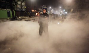 Tottenham riots: A policeman in riot gear
