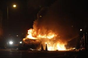 Tottenham riots: A police car burns on a street in Tottenham