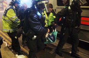 Tottenham riots: Police carry away an injured officer