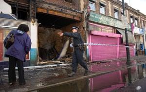 Tottenham riots: A police officer sets up a cordon