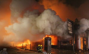 Tottenham riots: Fire fighters attempt to put out a blaze