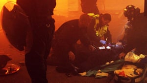 Tottenham riots: Police attend to an injured policeman
