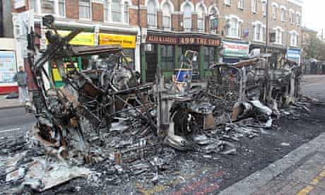 In Tottenham, rioters set fire to buildings and vehicles, including this double-decker bus