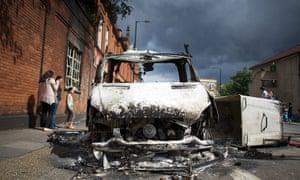 Tottenham riots: A burnt out police vanon Tottenham High Road