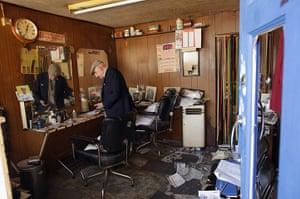 Tottenham riots: Aaron Biber, 89, assesses the damage to his hairdressing salon