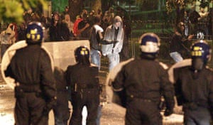 London riots: Police clash with youths in Brixton