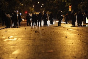 London riots: Police are confronted by several hundred youths in Brixton
