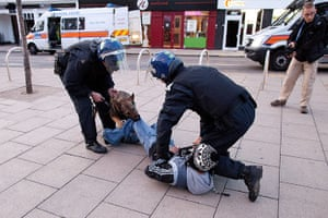 London riots: A man is detained by police using dogs in Enfield, North London