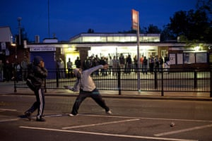 London riots: Youths throw bricks at police during unrest in Enfield, north London