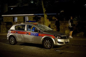 London riots: A police car shows severe damage caused by youths in Enfield, north London