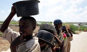 Somali boys queue to collect food relief