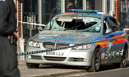 A damaged police vehicle is pictured in Enfield, north London