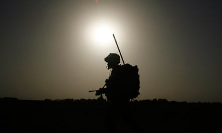 A British soldier patrols in Helmand province