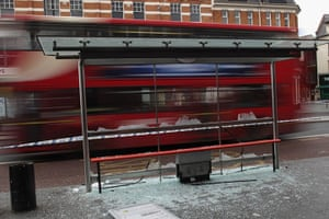 London Riots: A smashed bus shelter in Brixton