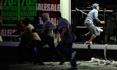 UK riots: Looters run from a clothing store in Peckham, London