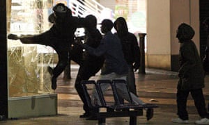 People attack a jewellers shop near the Bullring shopping centre in Birmingham, on August 8 2011
