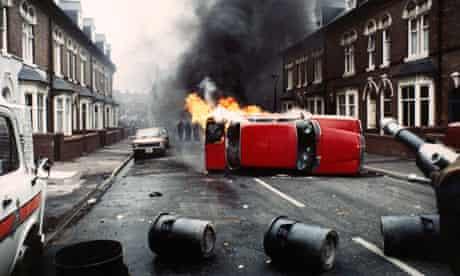 A burning car in Handsworth, 1985