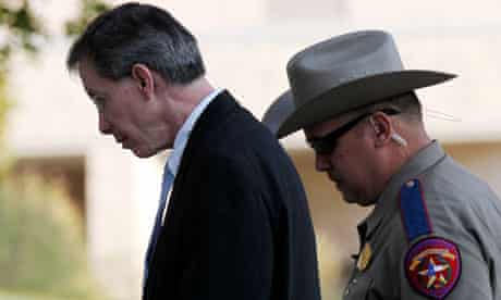 Warren Jeffs is escorted into the Tom Green County Courthouse