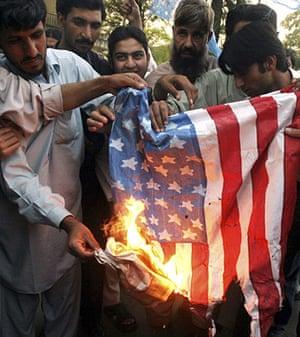 10 best: Activists of Muttahida Majlis-e-Amal burn a US flag