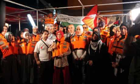 Pro-Palestinian activists hold a news conference on board the Turkish ship Mavi Marmara